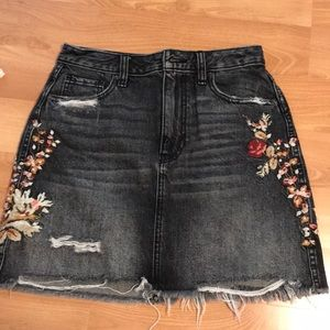 ripped black jean skirt with floral print